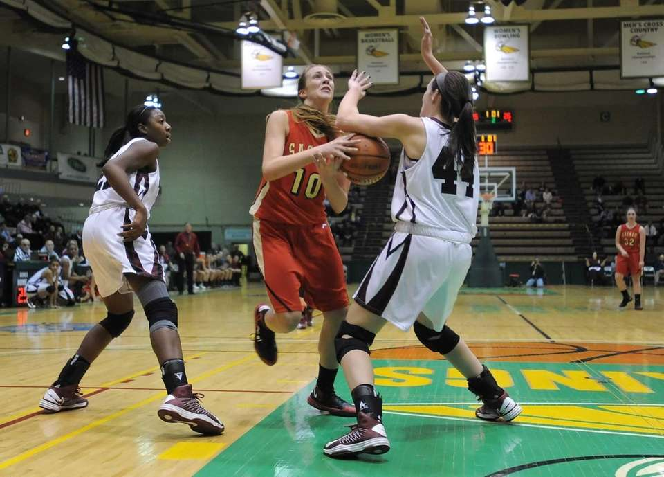 Sachem East's Kathleen Everson, center, loses her handle