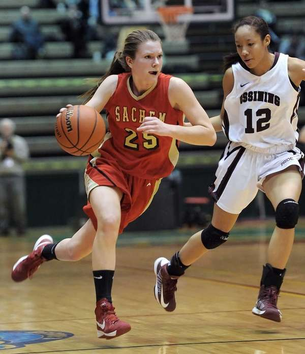 Sachem East's Katie Doherty, left, carries the ball