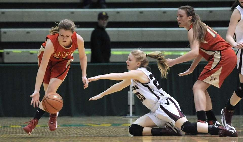 Sachem East's Katie Doherty, left, collects a loose