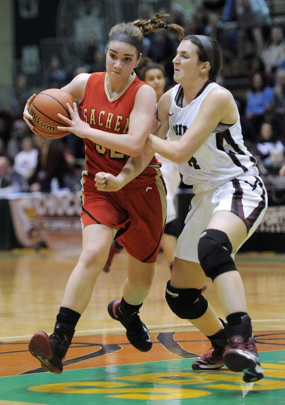 Sachem East's Sammy Drake, left, draws a foul