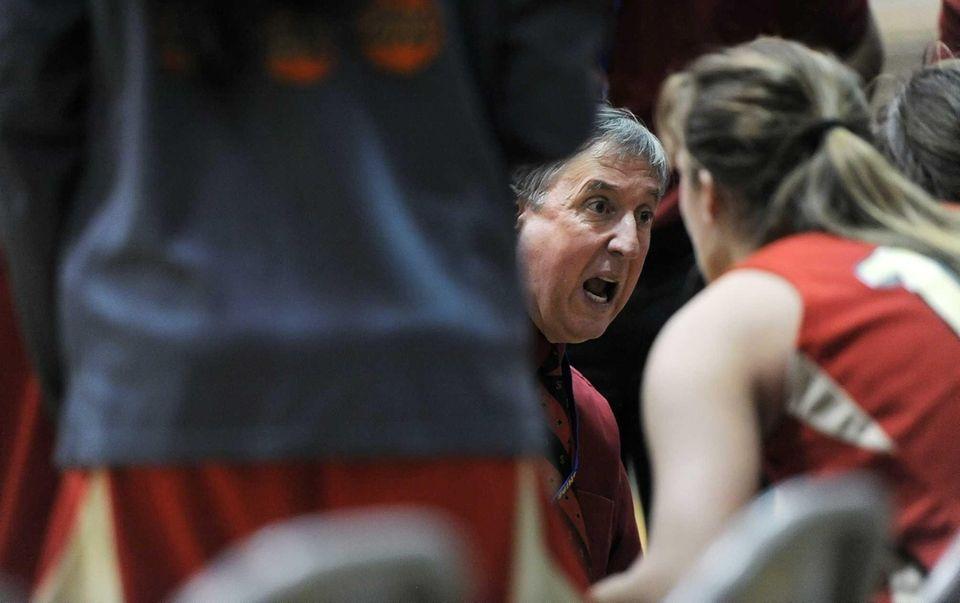 Sachem East coach Matt Brisson, facing, instructs his