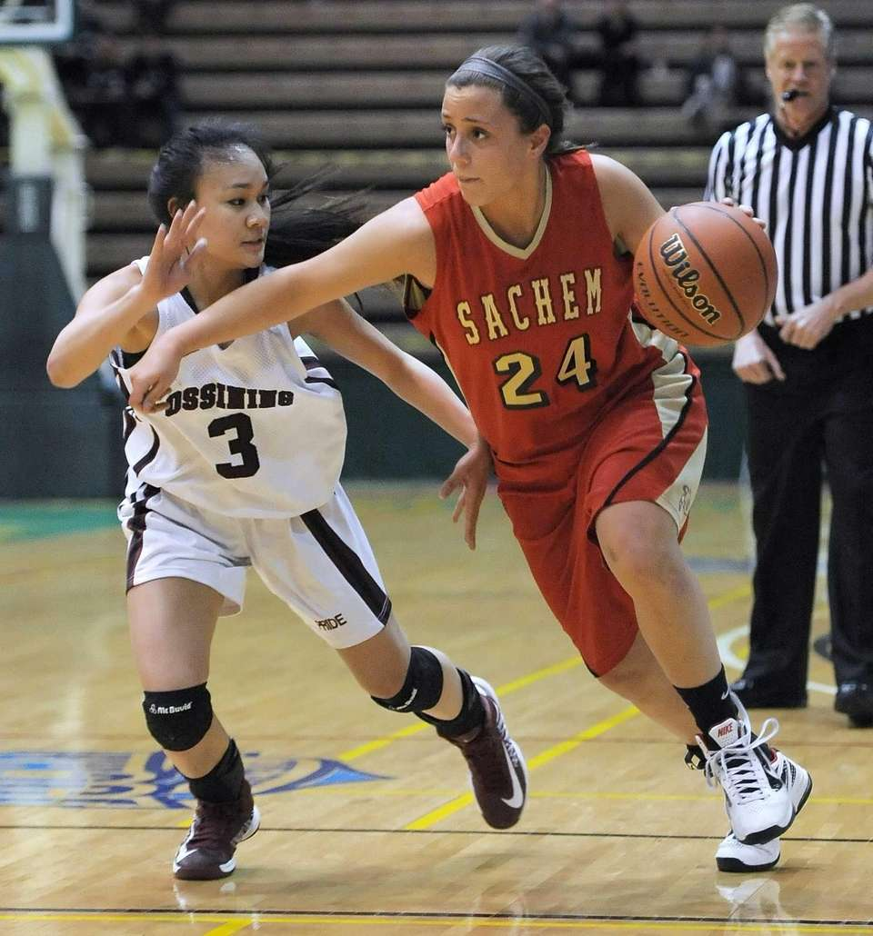 Sachem East's Emily Carmel, right, drives by Ossining's