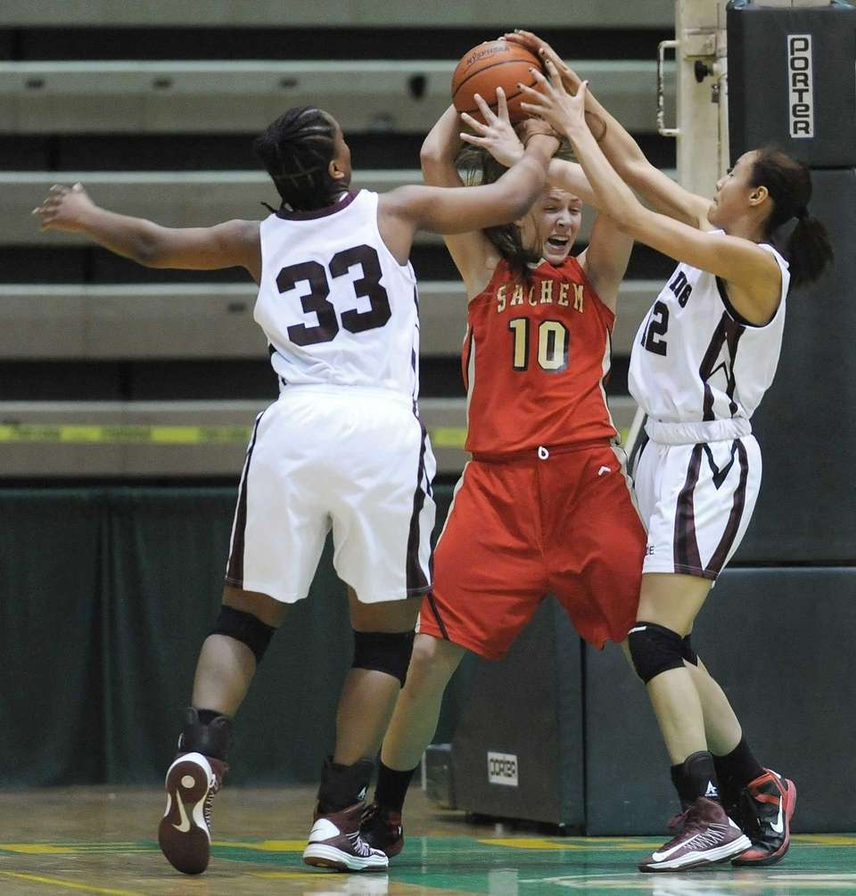 Sachem East's Kathleen Everson, center, is pressured by