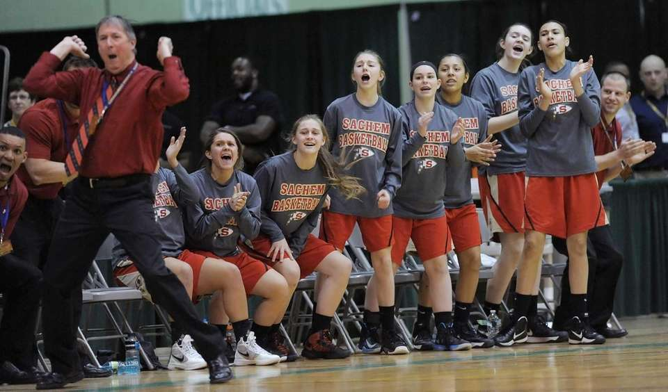 Sachem East's bench reacts to an early three-point