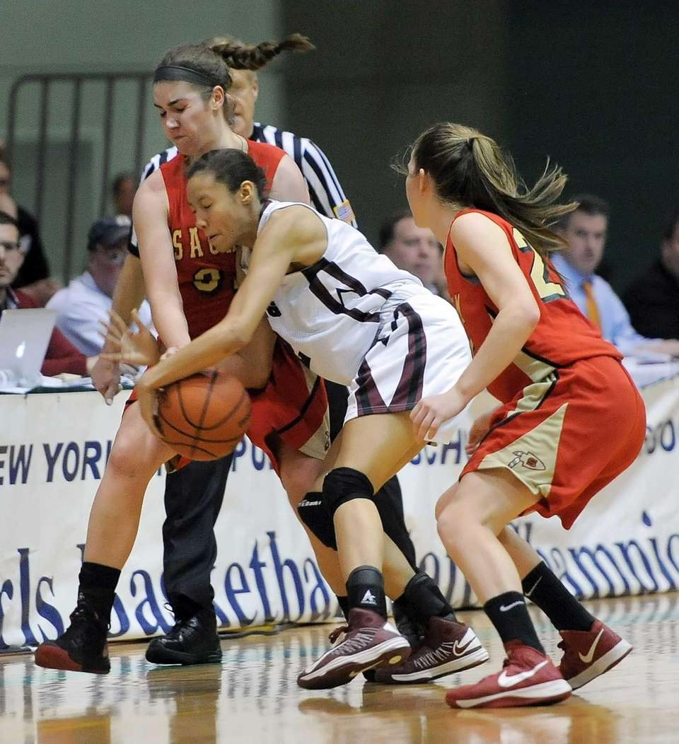 Sachem East's Sammy Drake, left, collides with Ossining's