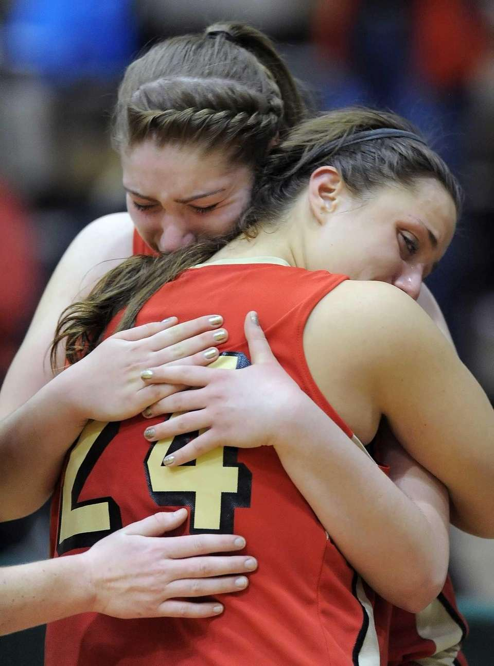 Sachem East's Allie Drake, facing, hugs teammate Emily