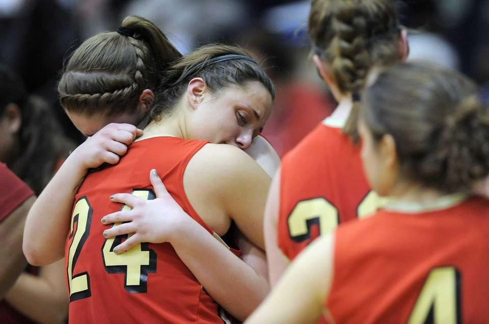 Sachem East's Allie Drake, left, hugs teammate Emily