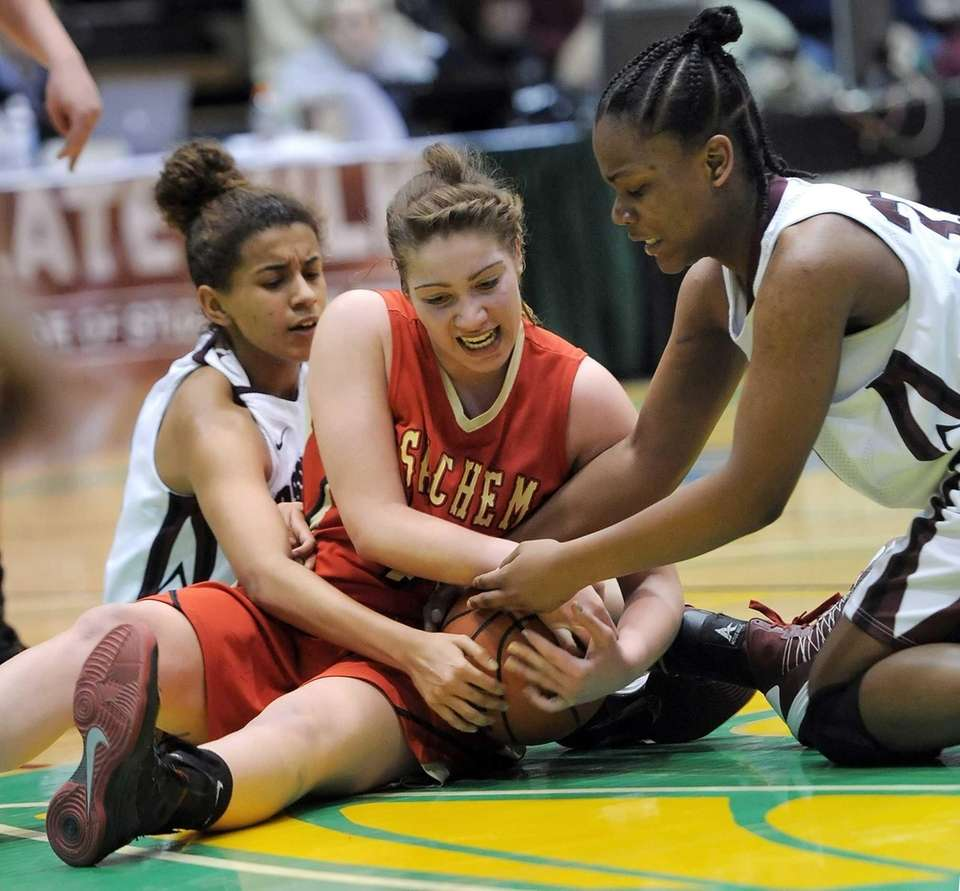 Sachem East's Allie Drake, center, fights for possession