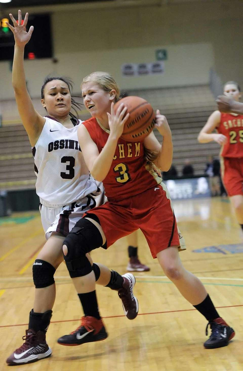 Sachem East's Christina Schretzman, right, drives the baseline