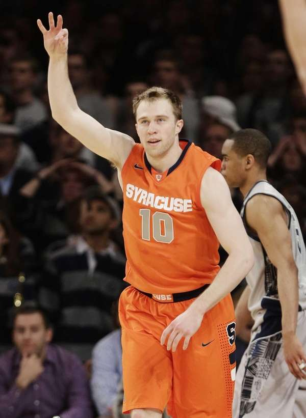 Syracuse's Trevor Cooney celebrates after making a three-point