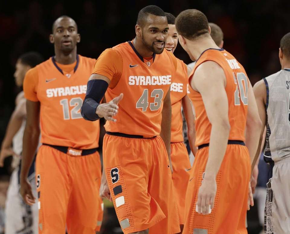 Syracuse's James Southerland celebrates with teammate Brandon Triche