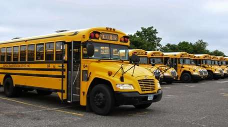 Suffolk Transportation school buses sit in the bus