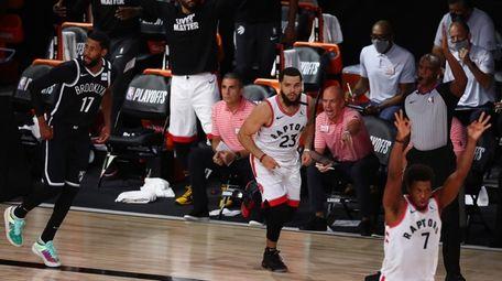 Toronto Raptors celebrate a basket by guard Fred