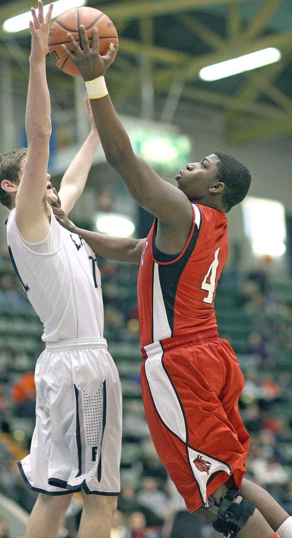 Amityville's Mike Alston goes for layup during the