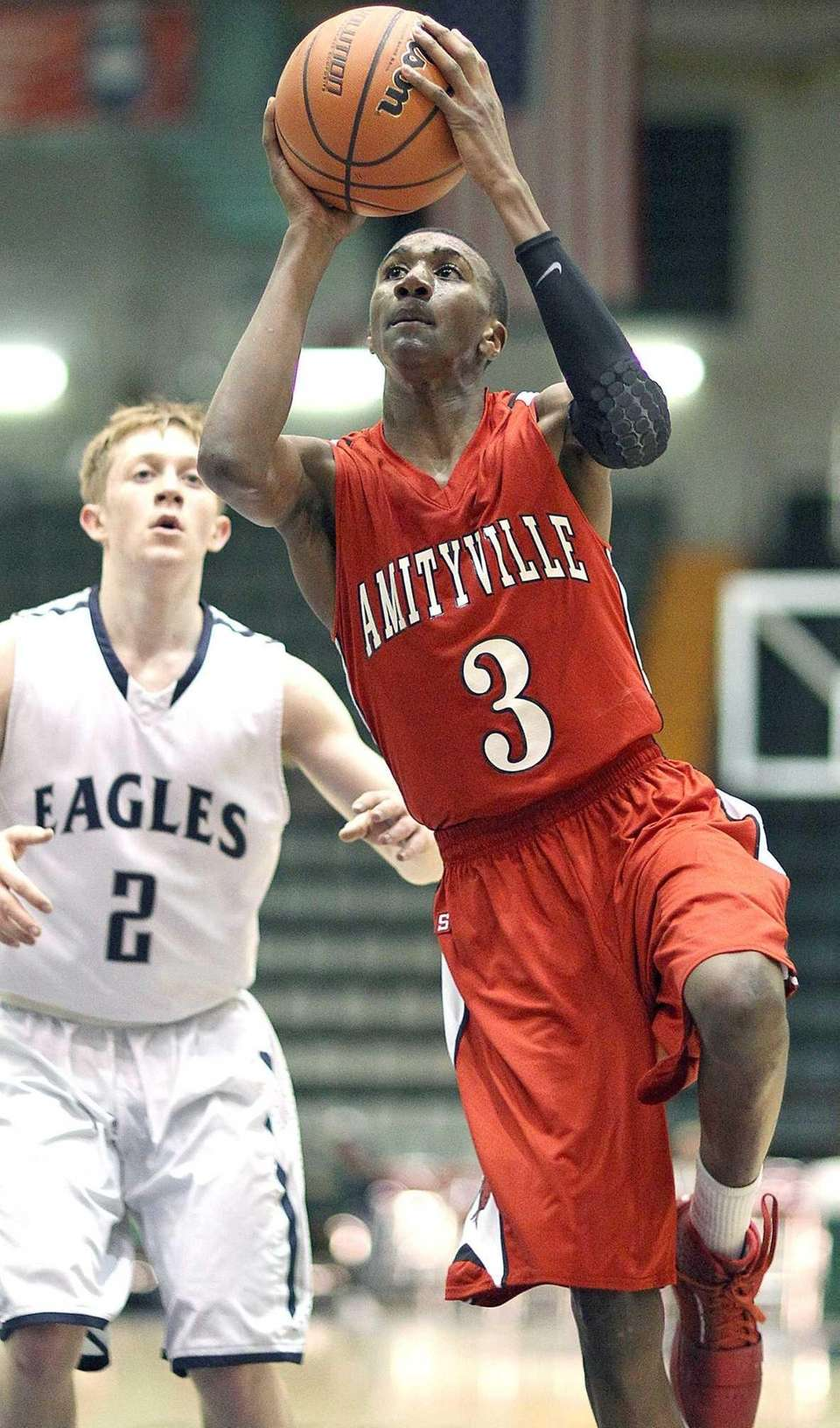 Amityville's Travis Dickerson goes against Jack Dwyer during