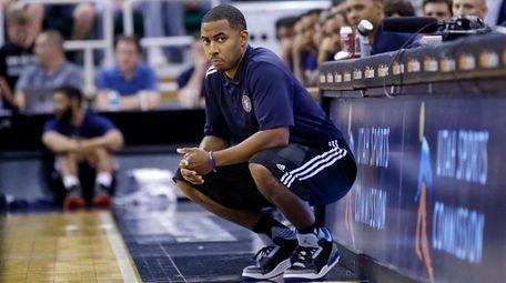 Utah Jazz coach Johnnie Bryant watches during the
