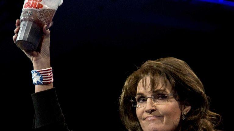 Former Alaska Gov. Sarah Palin holds up a