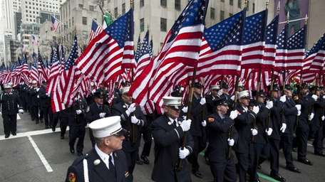 Members of FDNY march on Fifth Avenue during