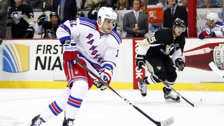 Micheal Haley of the Rangers handles the puck