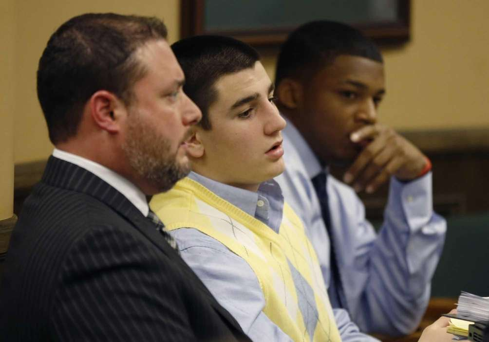 From left, defense attorney Adam Nemann, defendant Trent