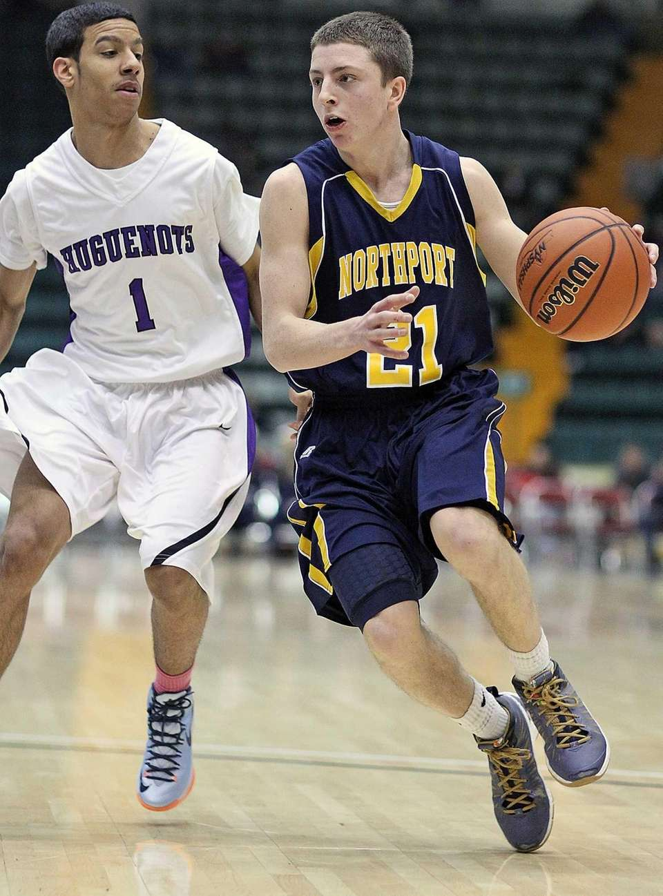Northport's Austin Marchese runs against Donny Powell. (March
