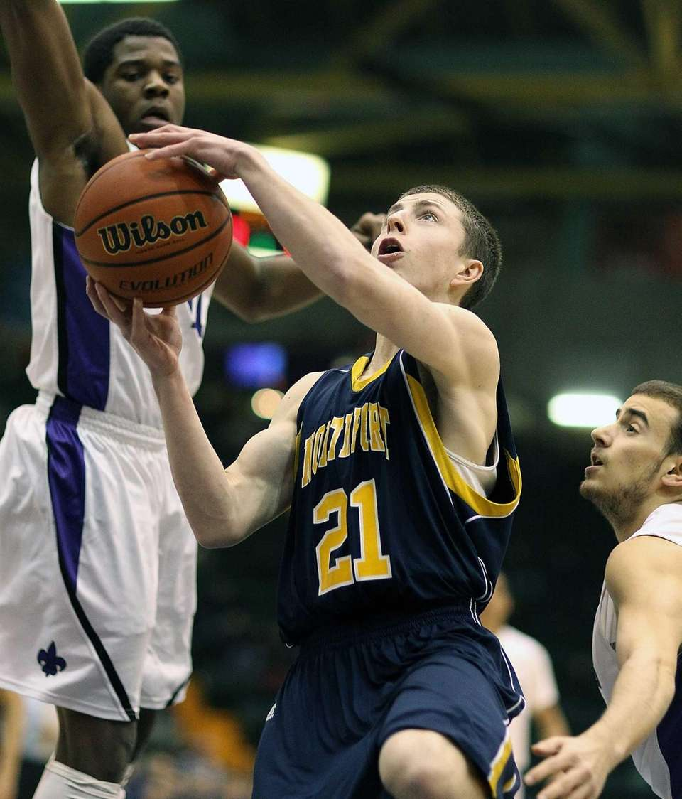 Northport's Austin Marchese sinks early basket during the