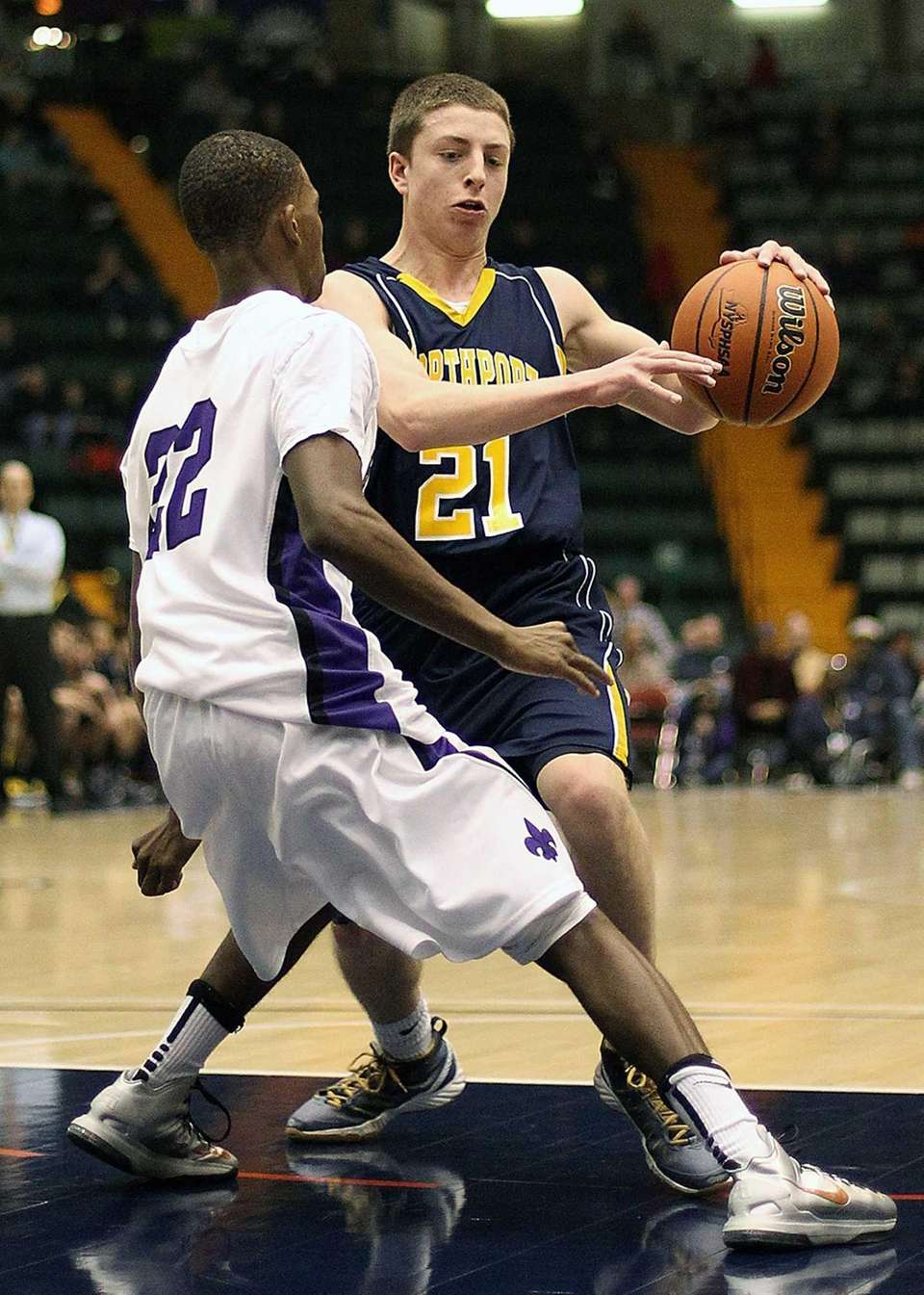 Northport's Austin Marchese moves down court during the