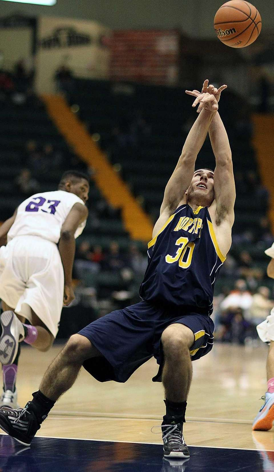The ball bounces over the head of Northport's