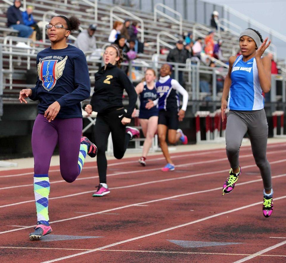 North Babylon's Nailah Jones, left, wins the 100