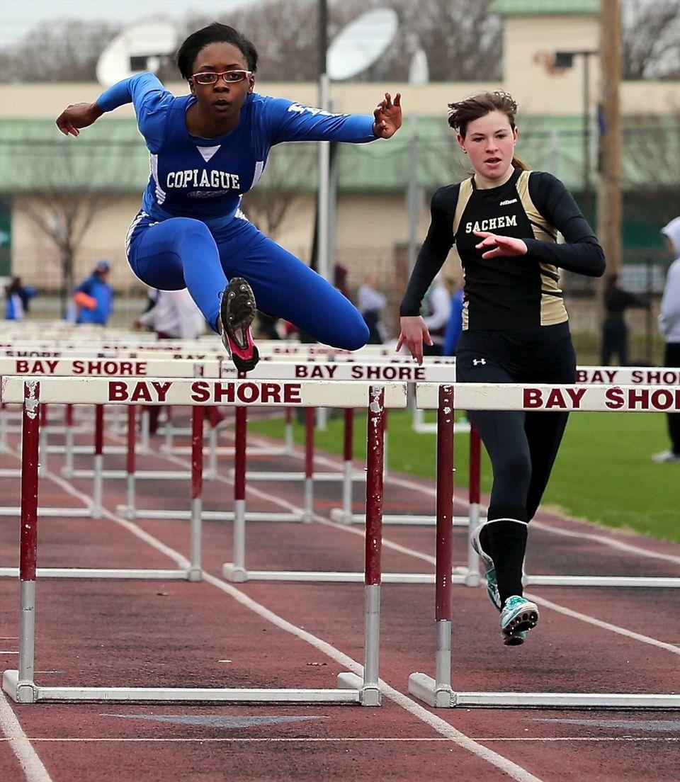 Copiague's Zyare Brown (left) wins the 100 meter