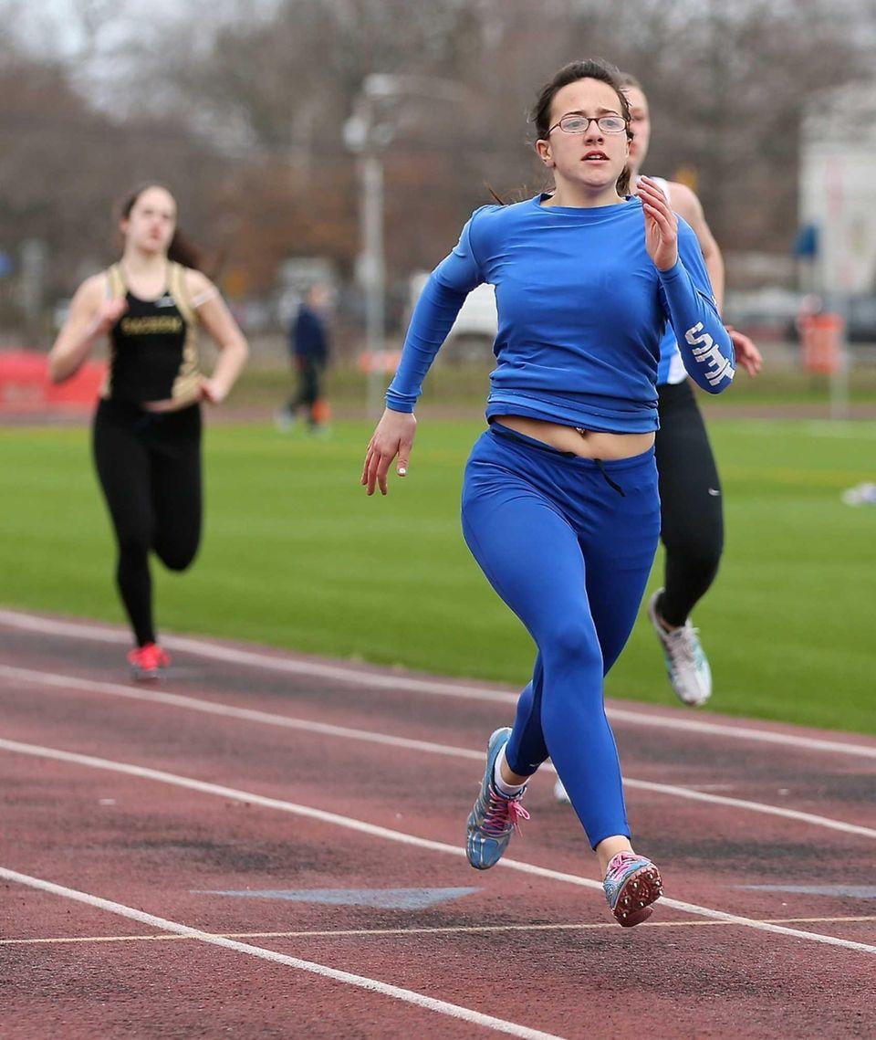 Copiague's Ashley Arquer wins the 200 meter dash.