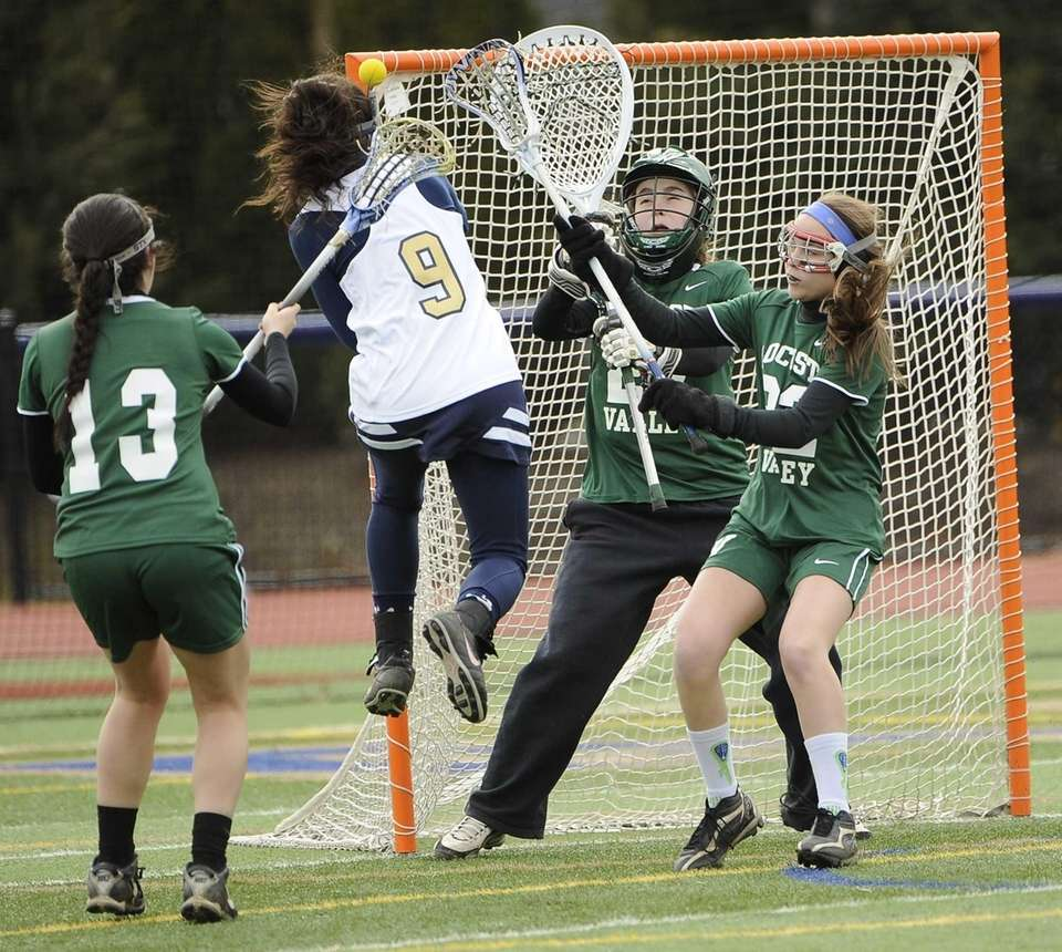 Bethpage's Gillian McGowan scores on Locust Valley goalkeeper