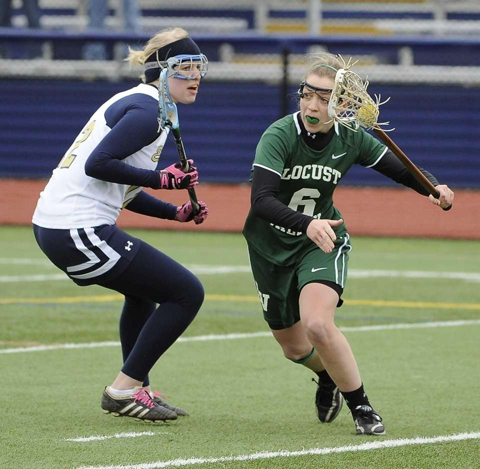 Locust Valley's Bairre Reilly is defended by Bethpage's
