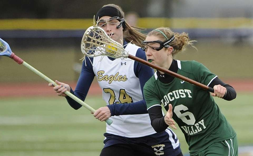Locust Valley's Bairre Reilly drives the ball as