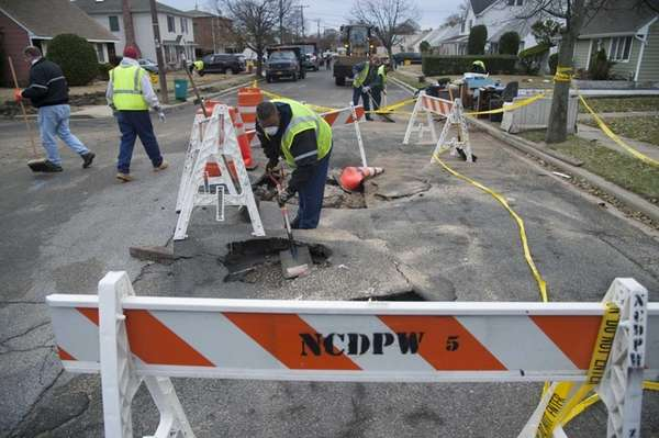 Nassau County Department of Public Works employees clear