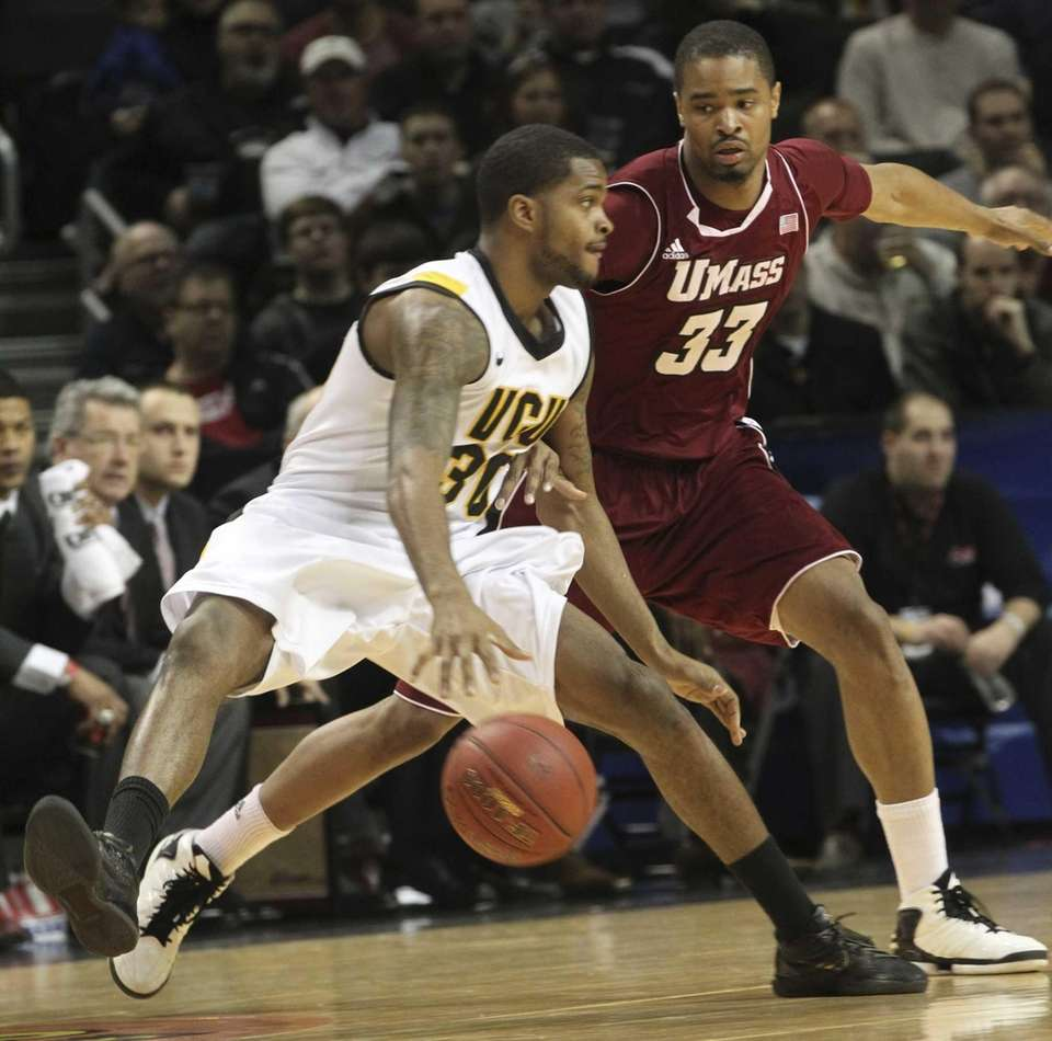 Virginia Commonwealth's Troy Daniels drives past Massachusetts' Terrell