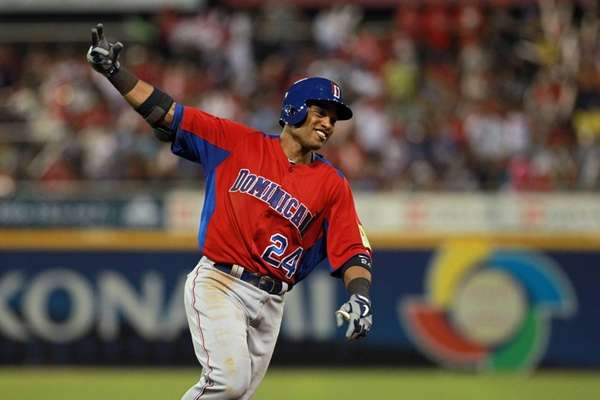 Dominican Republic's Robinson Cano celebrates after hitting a