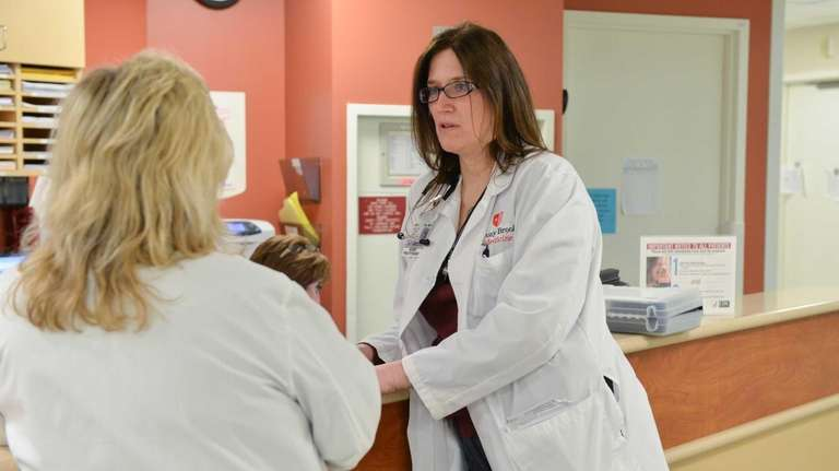 Jeanne Martin, a nurse practitioner, speaks with a