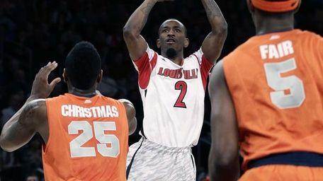 Louisville's Russ Smith shoots over Syracuse's Rakeem Christmas