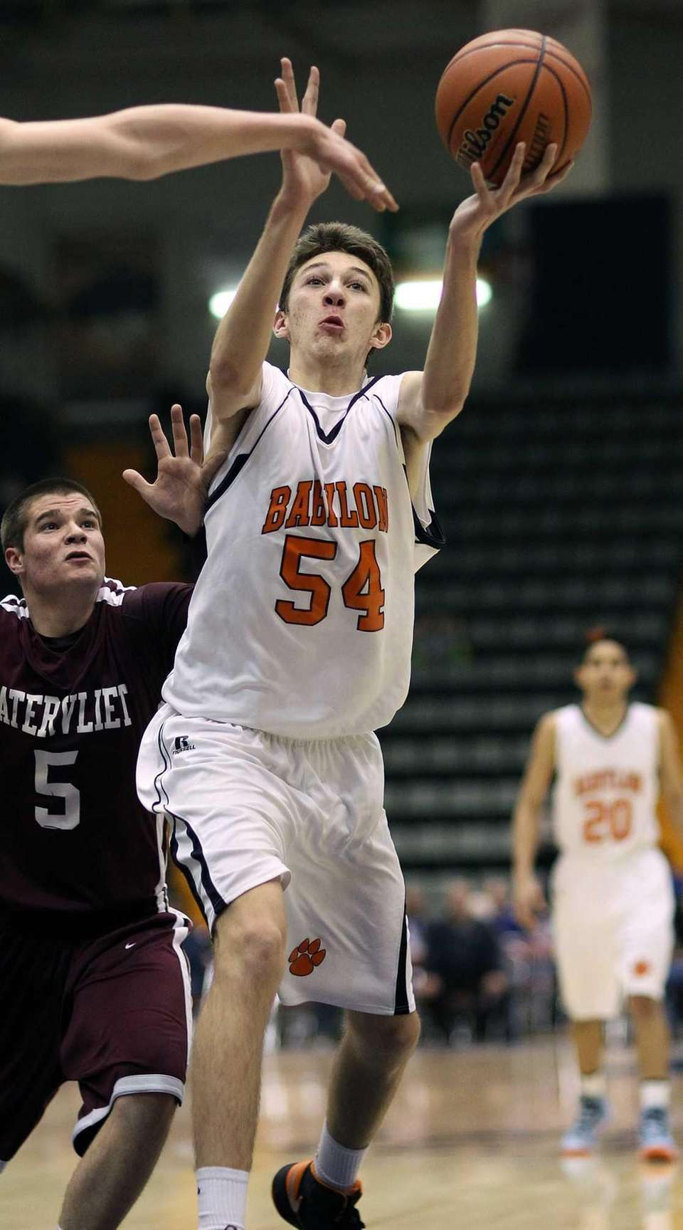 Babylon's Brendan Laing goes for the ball. (March