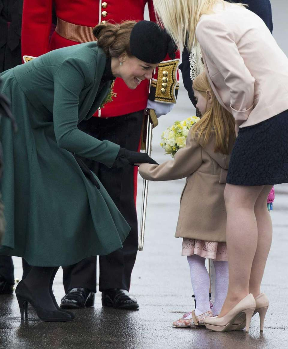 Britain's Kate the Duchess of Cambridge receives flowers