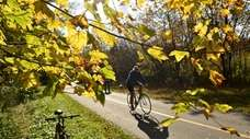 A cyclist cruises down the Bethpage Bikeway at