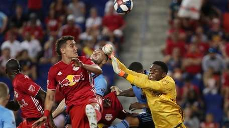 New York City FC goalkeeper Sean Johnson punches