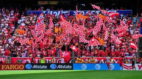Red Bulls supporters cheer on their team late