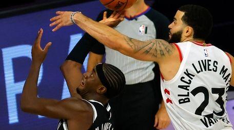 Fred VanVleet of the Raptors blocks a shot