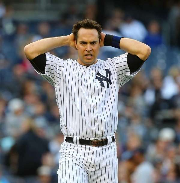 Mark Teixeira looks on after he was left