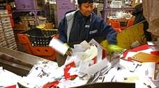 U.S. Postal Service worker Tru Wright feeds a