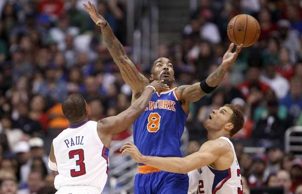 J.R. Smith battles with Los Angeles Clippers guard