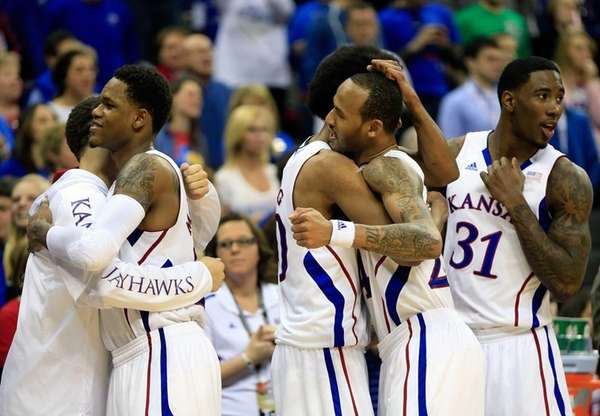 Kansas' Ben McLemore #23, Kevin Young #40, Travis