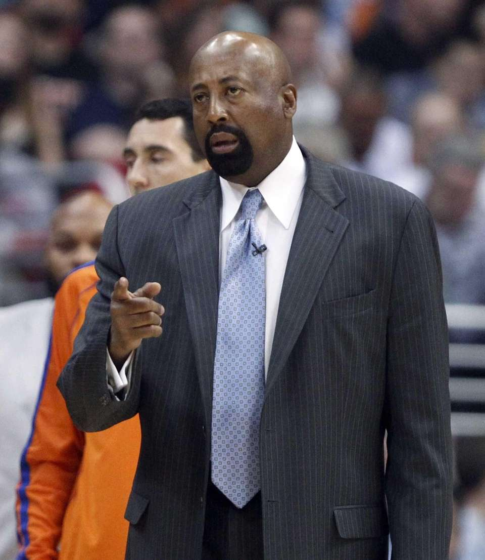 Knicks head coach Mike Woodson talks to an
